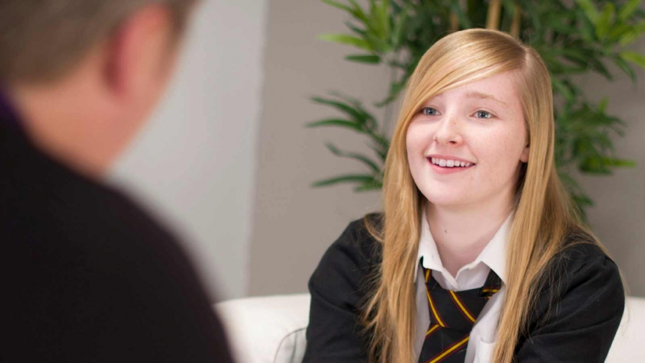 Young woman receiving career guidance